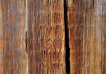 .Bright boards with knots and cracks