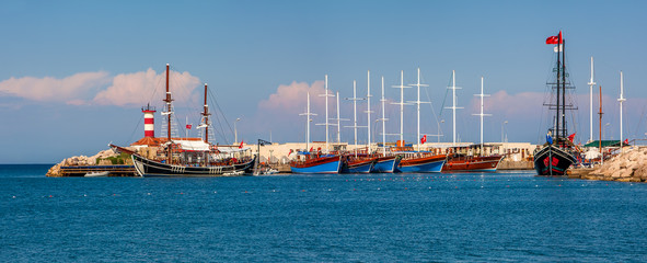 Sailing ships in marina on Mediterranean sea.