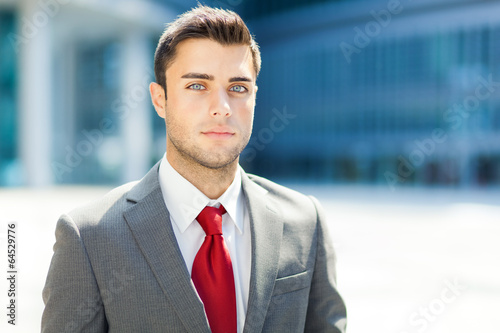 Very handsome businessman in an urban setting
