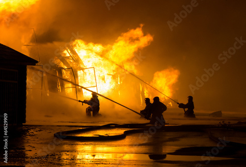Leinwanddruck Bild Firemen at work