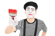 Mime artist holding a paintbrush