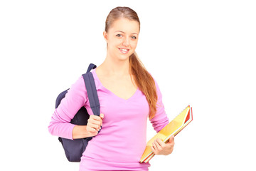 Female student holding backpack and book