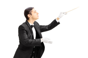 Male orchestra conductor directing with stick