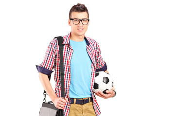 Man holding a bag and football