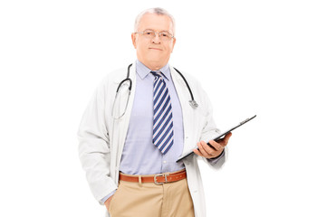 Mature doctor holding a clipboard