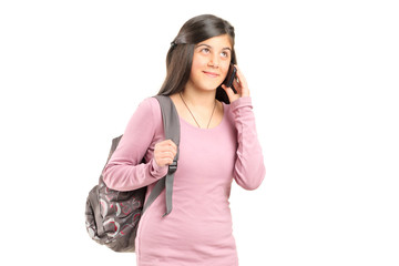Schoolgirl talking on a mobile phone