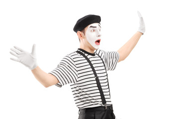 Surpised mime artist gesturing with hands