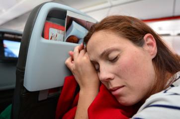 Woman sleep during flight