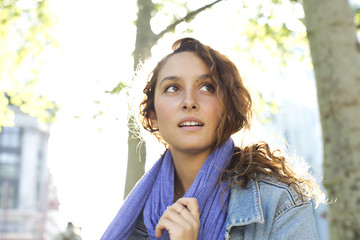 Attractive young woman looking off camera