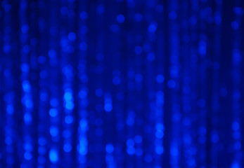 Blue abstract bokeh background with vertical stripes blurred