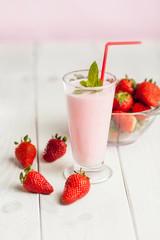 Strawberry milk shake in pastel colored .
