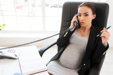 Pregnant business lady.