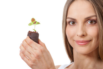 young woman holding plant,  coleus sprout
