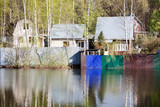 Russian rural landscape, home on the water, spring