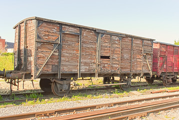 old vintage  train wagon on the rails
