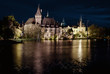 Night view of Vajdahunyad castle from lakeside. Budapest, Hungar