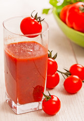 tomato juice and fresh organic cherry tomato