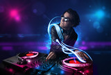 Fototapety Disc jockey playing music with electro light effects and lights