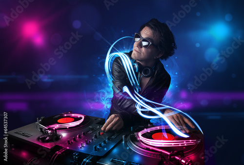 Disc jockey playing music with electro light effects and lights - 64537307