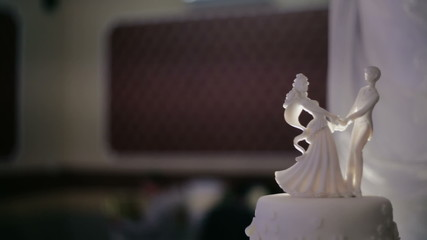 Wedding cake and groom figurines