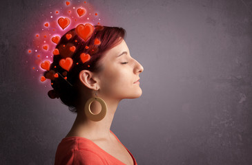 Young person thinking about love with red hearts