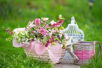 Spring blossoms and decorative wicker watering can