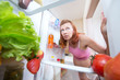 pregnant woman and refrigerator with health food