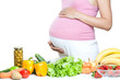 pregnant woman belly with vegetables and fruits