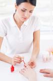 Confident manicurist at work. poster