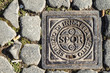 Roman Drain Cover with sign and abbreviation SPQR - 64540345