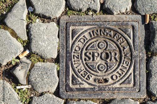 Leinwanddruck Bild Roman Drain Cover with sign and abbreviation SPQR