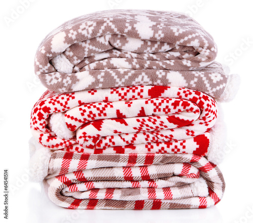 Pile warm plaids isolated on white - 64541514