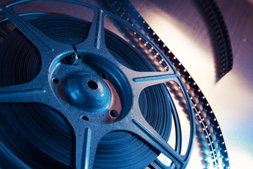 dramatic lit image of a movie reel