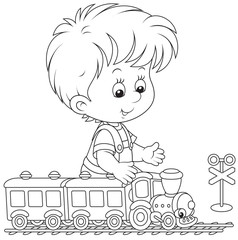 Child playing with a train