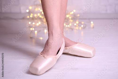 canvas print picture Ballerina in pointe shoes  in dance hall