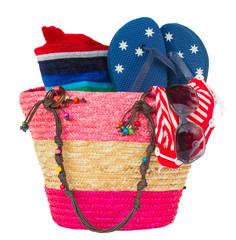 sunbathing accessories in pink straw bag