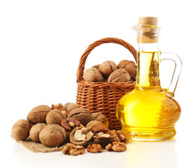 Walnut oil and nuts, isolated on white