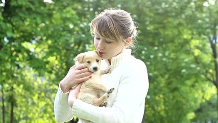 young woman stroking a puppy