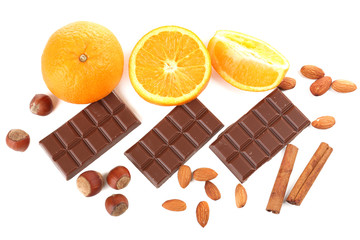 Chocolate, orange and nuts isolated on white