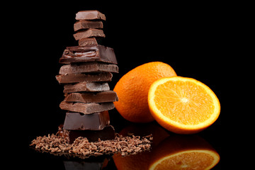 Chocolate and orange on black background