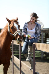 Beautiful girl and horse on nature background
