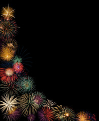 Festive fireworks display. Black background with copy space.