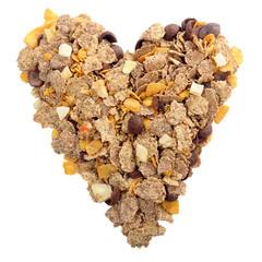 Whole grain muesli and bran breakfast in shape of heart