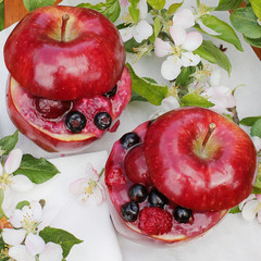 dessert in the garden. Inside apple jelly with fruit