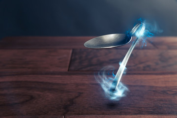 psychokinesis concept with bent spoon