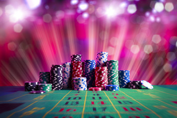 Casino chips with dramatic lighting and lens flares