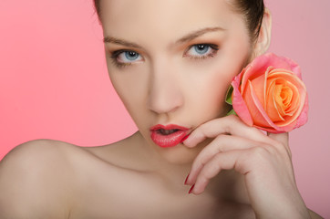 Seductive woman with rose