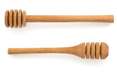 wooden honey  stick on white