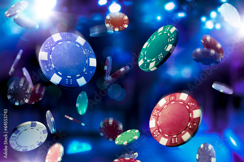 High contrast image of casino chips falling - 64553743
