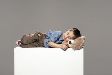 small boy sleep with bear